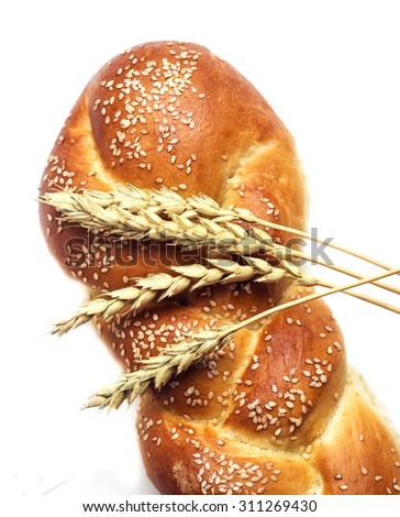 fresh bread and ears of wheat, isolated against white background - stock photo
