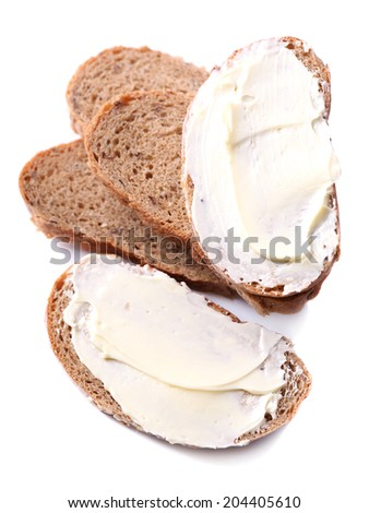 Fresh bread and homemade butter, isolated on white - stock photo