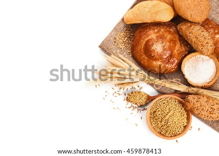 Fresh bread and wheat isolated on white
