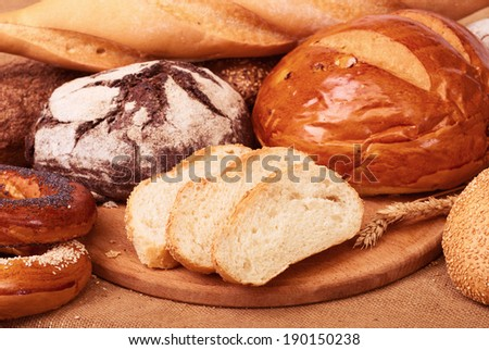 fresh bread and wheat on the burlap