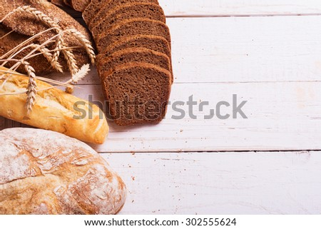 fresh bread and wheat on the wooden background