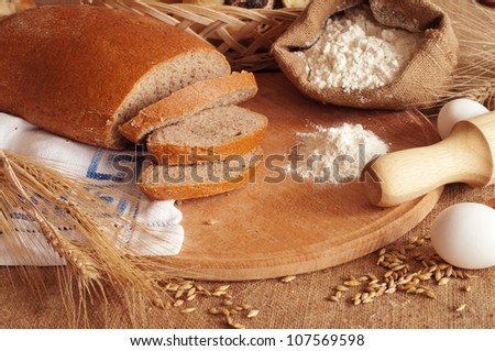 fresh bread and wheat spikelets - stock photo