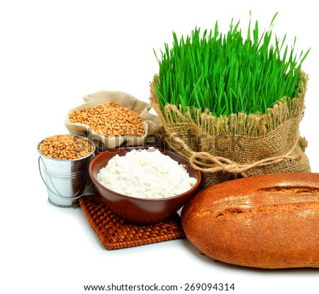 Fresh bread, flour, grain, green grass in the sack isolated on white background - stock photo