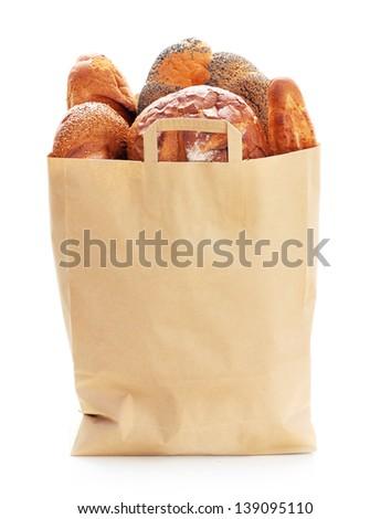 Fresh bread in paper eco bag. - stock photo