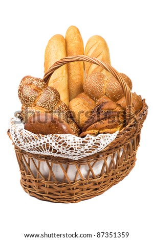 Fresh bread in the basket fully isolated. - stock photo