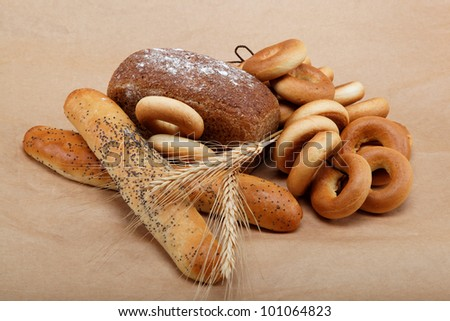 Fresh bread isolated on a light brown background.