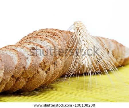 Fresh bread on a bamboo napkin. - stock photo