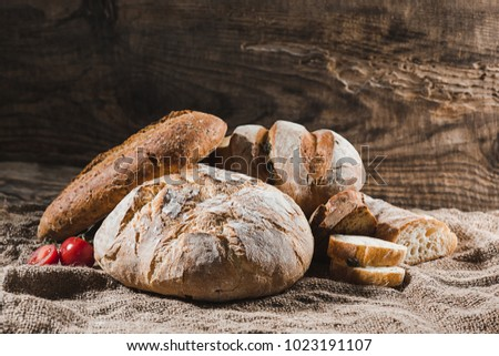 Fresh bread on table close-up. Fresh bread on the kitchen table The healthy eating and traditional bakery concept. Rustic style