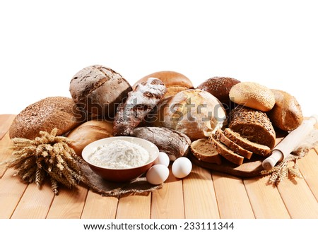 Fresh bread on table on white background - stock photo