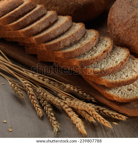 fresh bread on the wooden board - stock photo