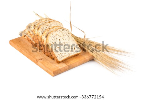 fresh bread on wooden plate and wheat on white - stock photo