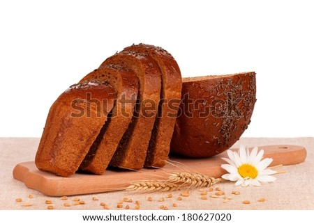 Fresh bread with caraway seeds on a cutting board on white background - stock photo