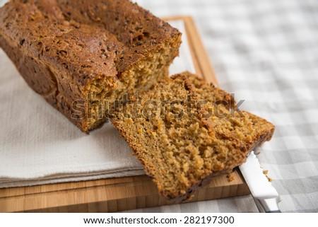 Fresh bread with carrots - stock photo
