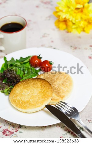 Fresh bread with coffee - stock photo