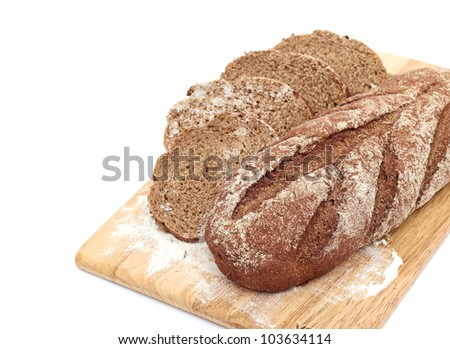 Fresh bread with ear of wheat isolated on white - stock photo