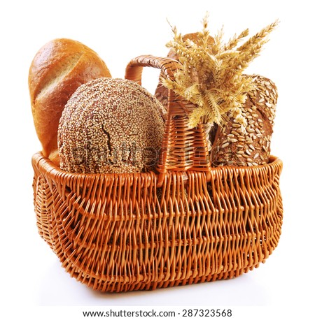 Fresh bread with wheat in wicker basket isolated on white - stock photo