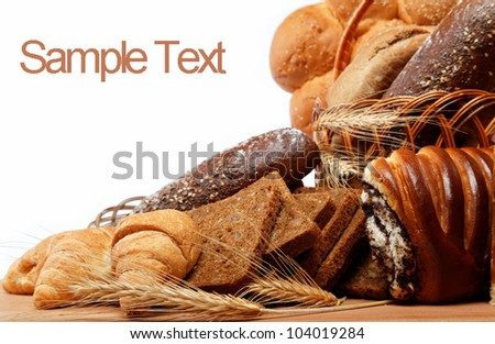 Fresh breads for a variety isolated on white.