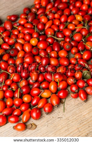 fresh brier  berries Christmas-tree on old wooden table. Vintage style - stock photo
