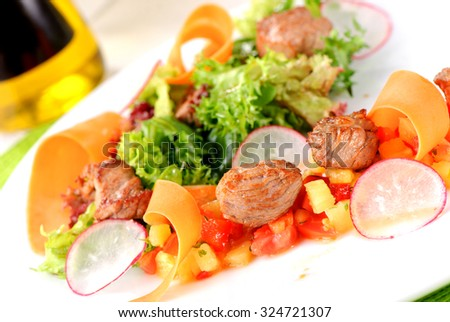 Fresh bright salad with meat and vegetables