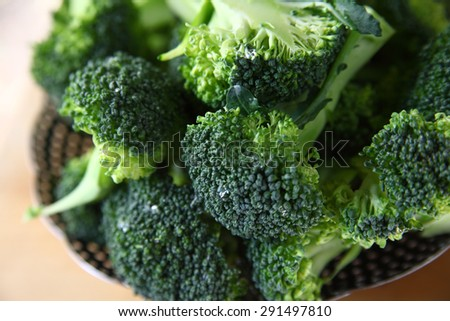 Fresh broccoli, cut up, washed and ready to steam - stock photo