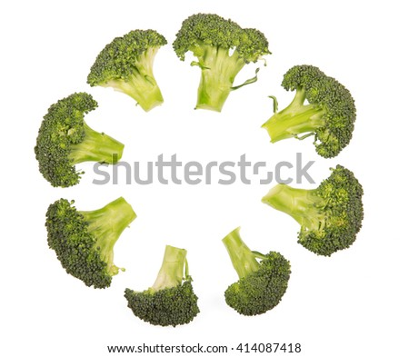 Fresh broccoli florets laid out in  circle isolated on white background.