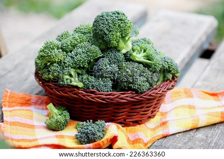 Fresh broccoli in a basket, organic food - stock photo