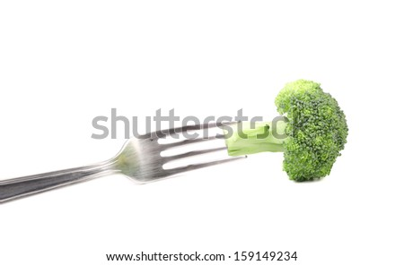 Fresh broccoli on a fork. Isolated on a white backgropund.