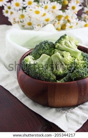Fresh broccoli on a rustic wooden table.