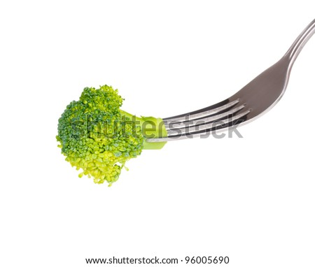 Fresh broccoli on fork isolated on white