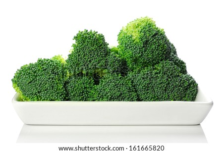 Fresh broccoli on white plate - stock photo