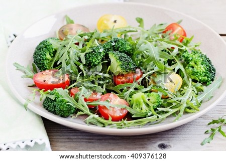 Fresh broccoli salad with cherry tomatoes mix and arugula.Selective focus