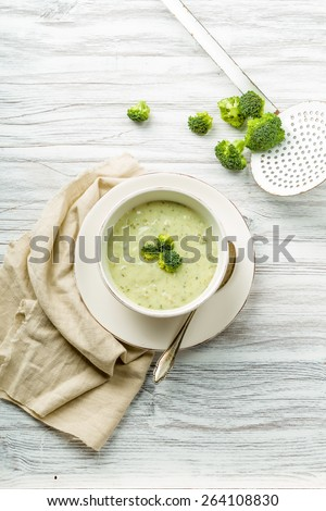 fresh broccoli soup with croutons and herbs - stock photo