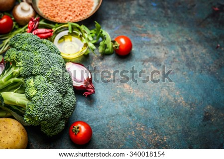 Fresh broccoli , various vegetables, red lentil and ingredients for cooking on rustic wooden background, border. Healthy food or diet eating concept. - stock photo