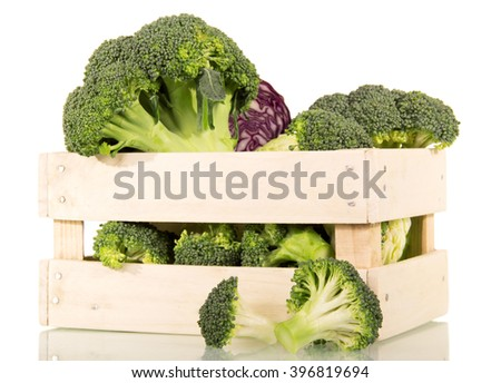 Fresh broccoli, white and red cabbage in a box isolated on white background. - stock photo