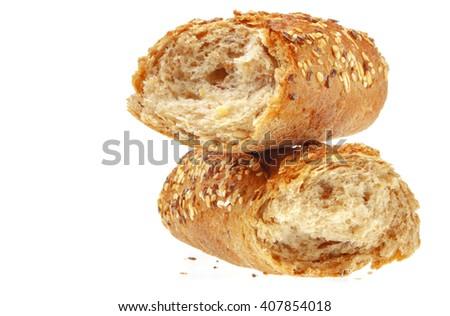 Fresh broken Baguette, over the white background. - stock photo