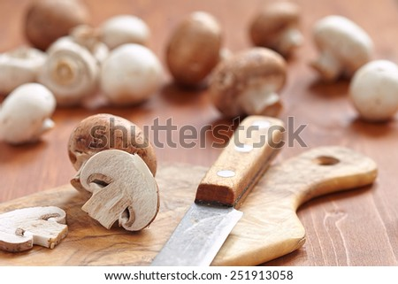 Fresh brown and white mushrooms with parsley - stock photo