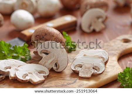 Fresh brown and white mushrooms with parsley