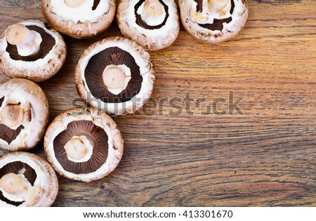 Fresh Brown Mushrooms on Woody Background Studio Photo - stock photo