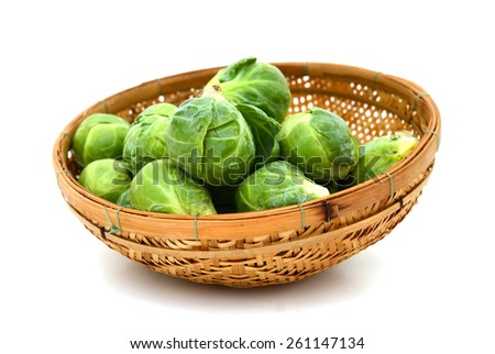 fresh brussel sprout cabbage in basket isolated on white