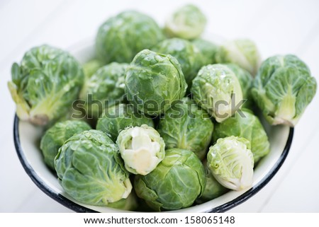 Fresh brussels covered with water drops, close-up, studio shot - stock photo
