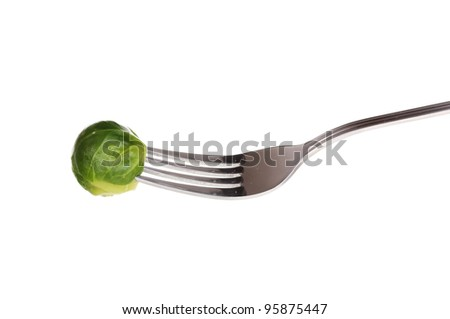 Fresh brussels sprout on fork isolated on white