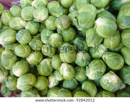Fresh Brussels sprouts in a box at the greengrocer on the market place - stock photo