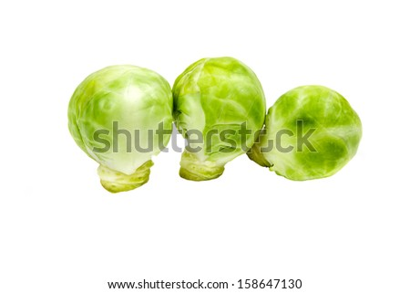 Fresh brussels sprouts isolated on white background - stock photo