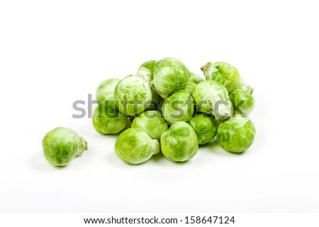 Fresh brussels sprouts isolated on white background with a light shadow