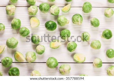 Fresh brussels sprouts over rustic wooden texture.healthy food - stock photo