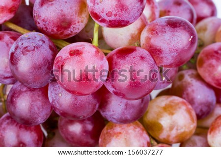 Fresh bunch of red grape on white background