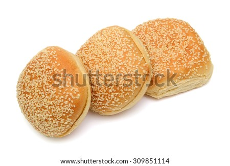 fresh buns with sesame seeds on top isolated on white