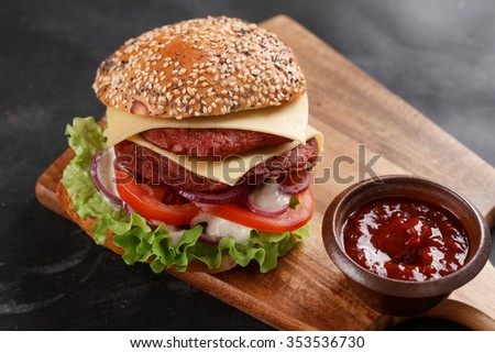 Fresh burger with cheese and sauce, selective focus - stock photo
