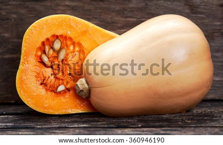 Fresh butternut squash slice on wooden table. - stock photo