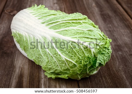 Fresh cabbage on a wooden background. Vegetable.